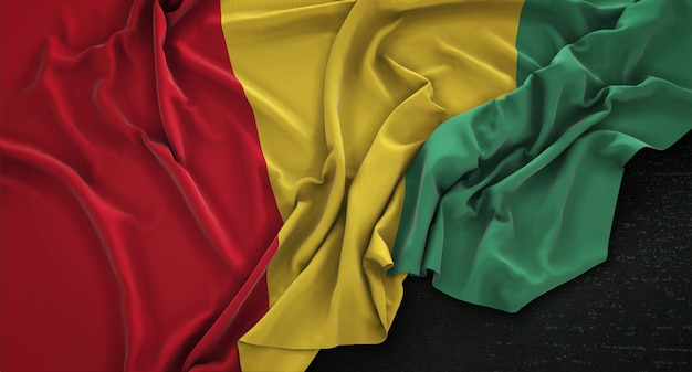 Guinea flag wrinkled on dark background 3d render