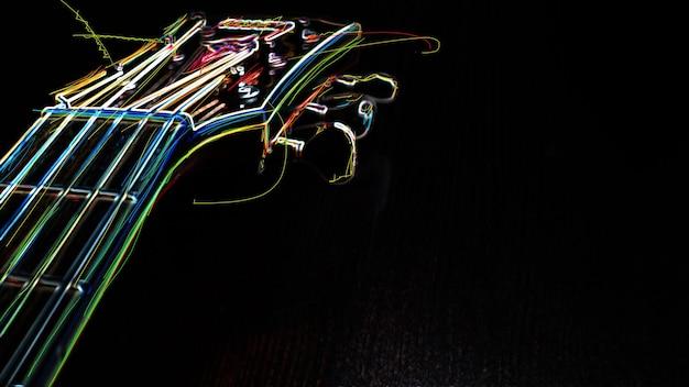 Грифа гитары. абстрактная цветная неоновая живопись.