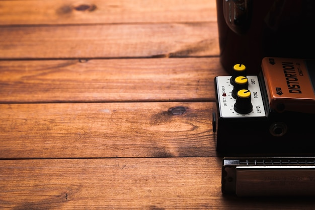 Guitar pedal on wooden tabletop