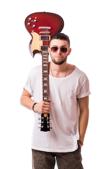 Guitar player man isolated on white wall
