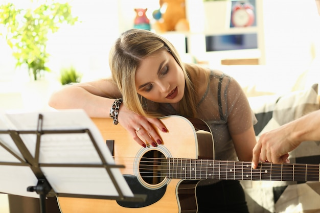 Guitar playing lesson music education concept