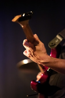 Guitarist hands playing electric guitar. close up.