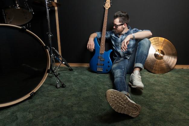 Guitarist and his guitar