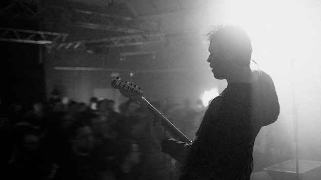 Guitarist playing electric guitar in a rock concert