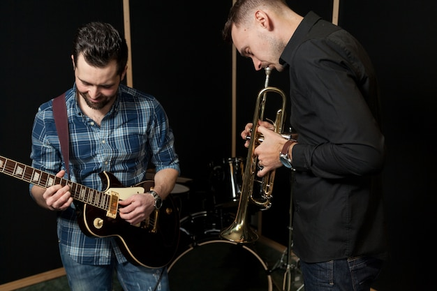 Guitarist and trumpet player having fun