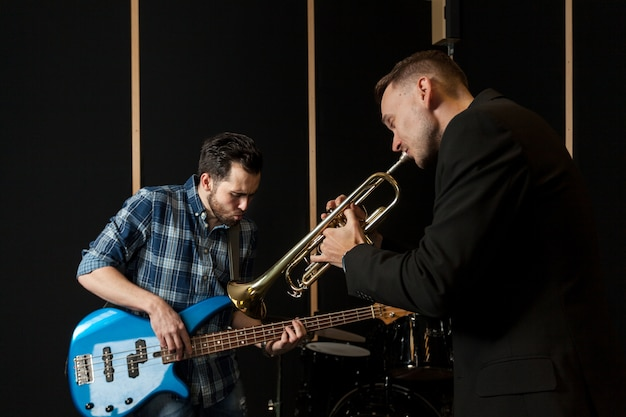 Guitarist and trumpet player performing