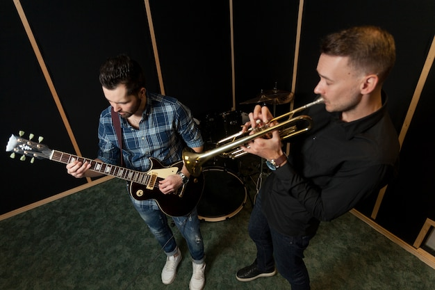 Guitarist and trumpet player rehearsing