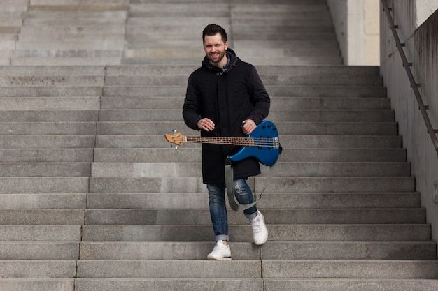 Guitarist walking downstairs