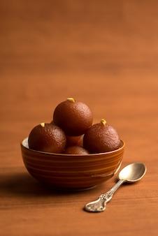 Gulab jamun in bowl . indian dessert or sweet dish.