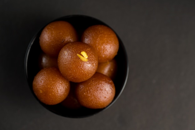 Gulab jamun in bowl. indian dessert or sweet dish.