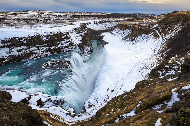 Gullfoss or golden waterfall in winter season