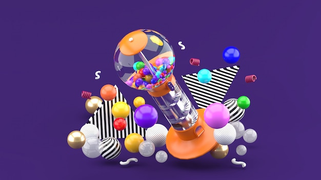 Gum ball machine among colorful balls on purple. 3d rendering.
