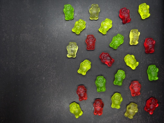 Gummy bears in black background with copy space