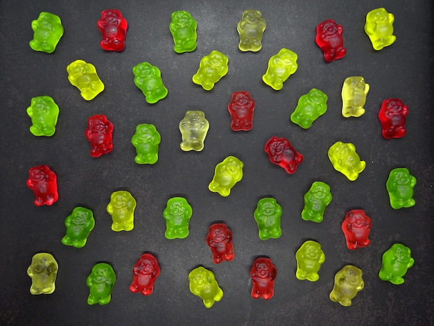 Gummy bears in black surface