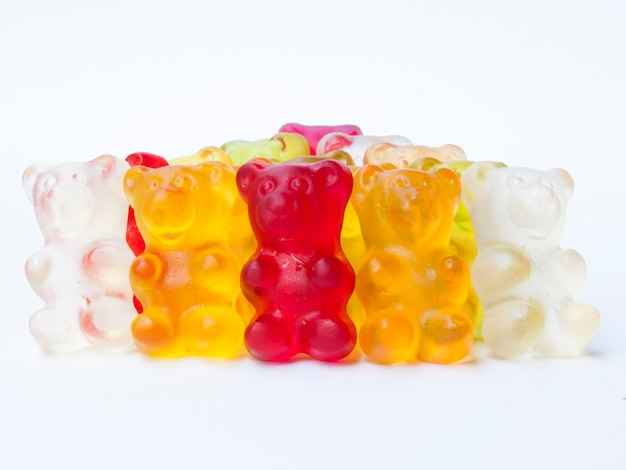 Gummy bears candy in row.