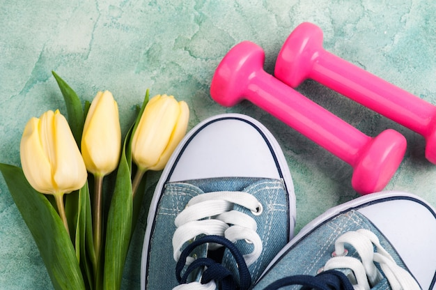 Gumshoes with tulips and pink dumbbells