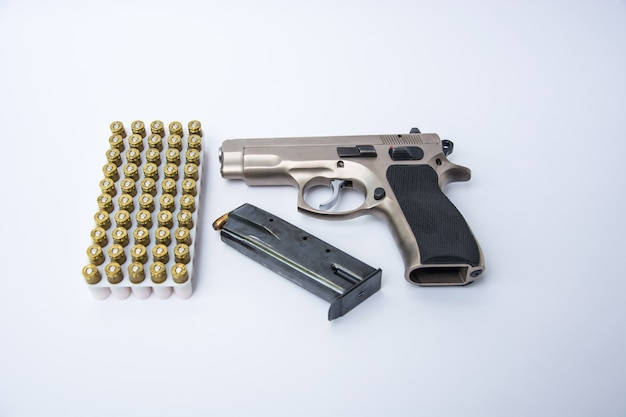Gun and ammunition isolated on white background.