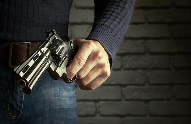 The gun in hands.