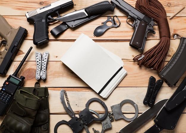 Gun, knife with sheath, compass