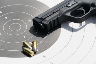 Gun with 9mm bullets on the target