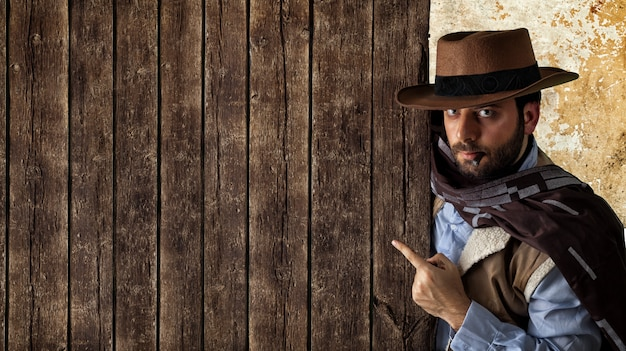 Gunfighter pointing on wooden table.