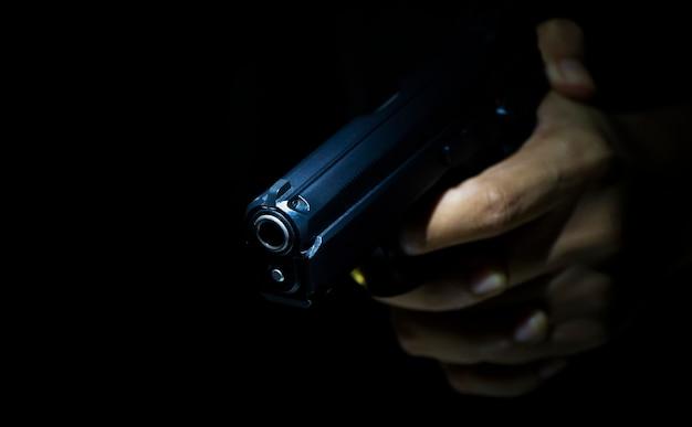 Gunman holding gun