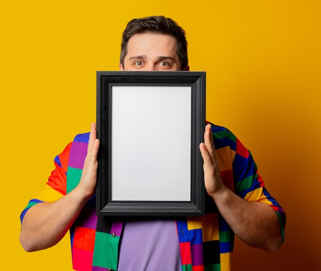 Guy in 90s shirt with photo frame