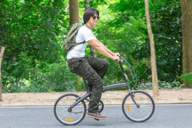 Guy and bicycle in the park