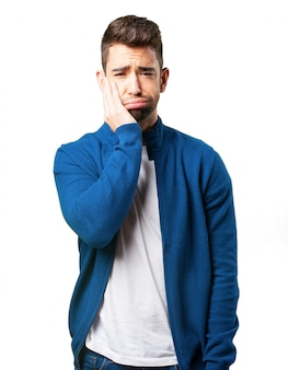Guy in a blue jacket with toothache