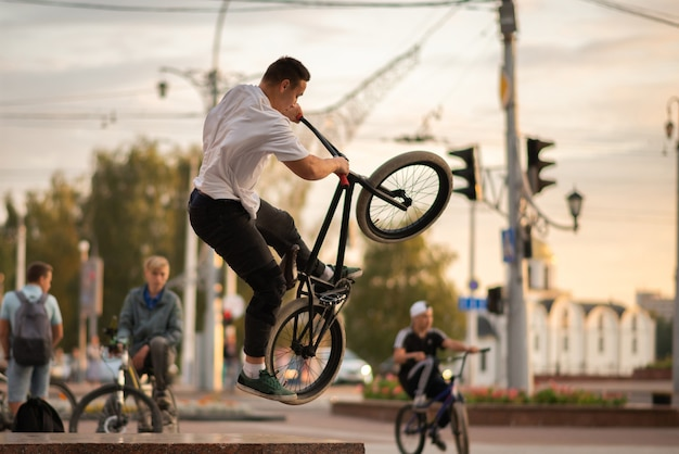 The guy on the bmx jumps up on the parapet. for any purpose.