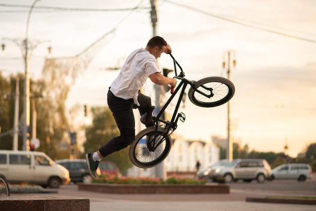 The guy on the bmx, performing a trick, jumps up from the parapet. for any purpose.