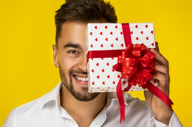The guy closed part of his face by a present