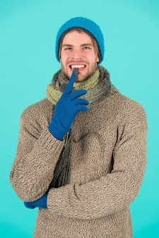 Guy feel warm and comfortable. male knitwear fashion. men knitted cloth and accessory. male blue background. poor homeless man. funny man feeling cold in winter. no flu. winter weather forecast.