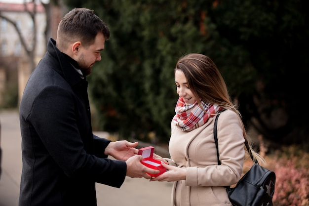 Guy gives a girl box with a gift