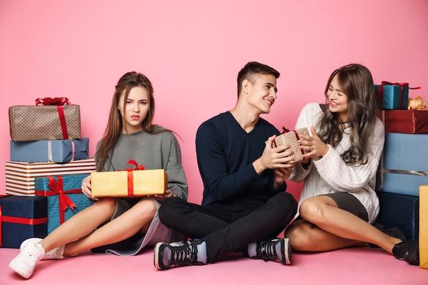 Guy giving christmas gift box to girl.