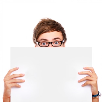 Guy in glasses holding blank board