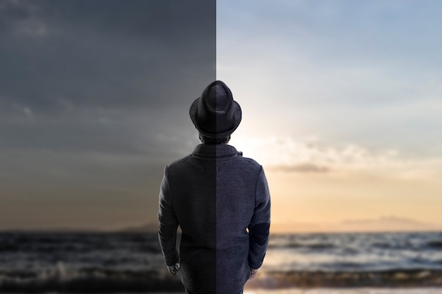 The guy in the hat looking at the sea