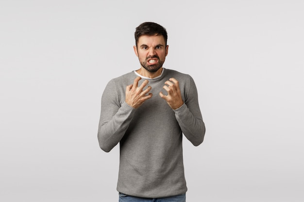 Guy hate everyone look with rage, hateful and furious expression, want choke someone, clench fists threatening, losing patience, look tensed and aggressive, grimacing annoyed