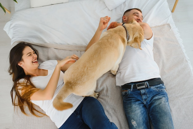 Guy and his girlfriend are resting in bedroom