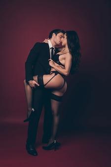 Guy hold girl leg and hip