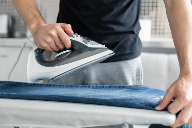 A guy ironing clothes before going outside