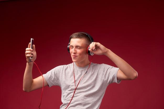 The guy is dancing with headphones