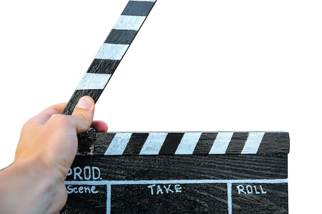 Guy is holding black clapperboard isolated on white background. man is directing and filming some amateur cinema movie.