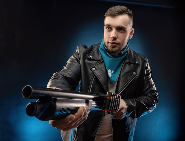 The guy in a leather jacket with a shotgun