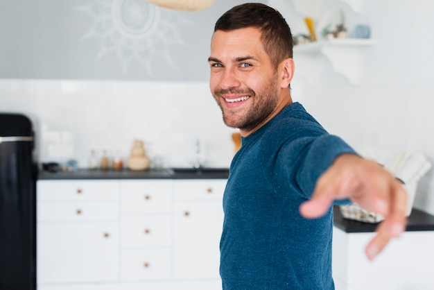 Guy looking at camera and stretching an arm