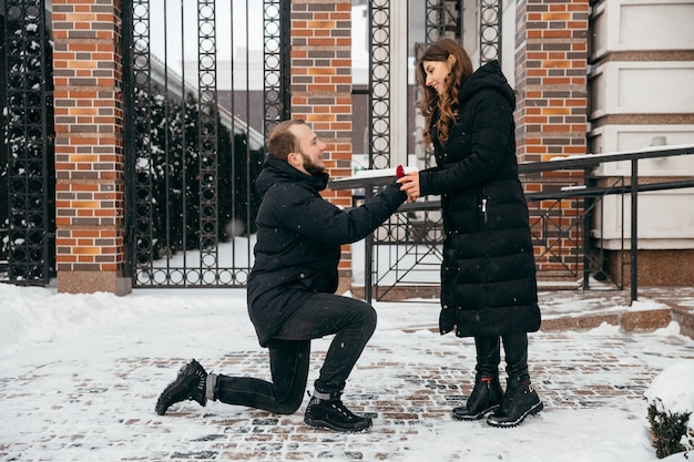 The guy makes a marriage proposal to his girlfriend. high quality photo