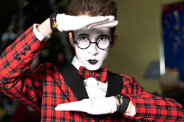 Guy mime with glasses shows emotions
