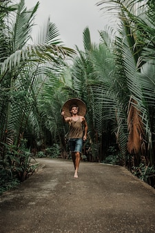 Guy on the road in the tropics