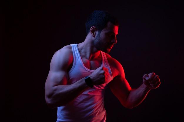 A guy in stance in dark room
