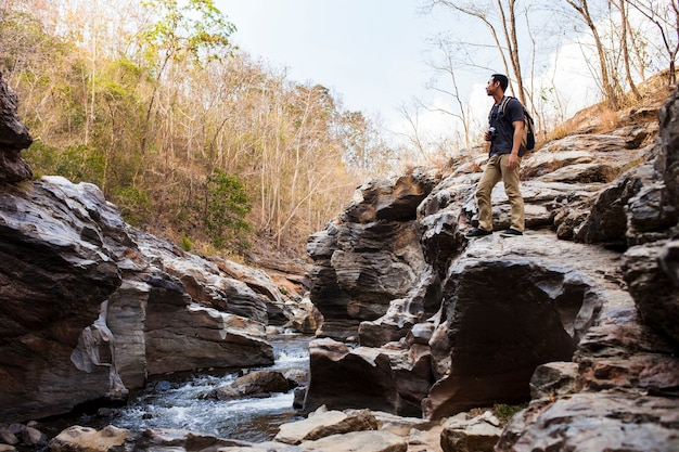 Guy standing near river Free Photo